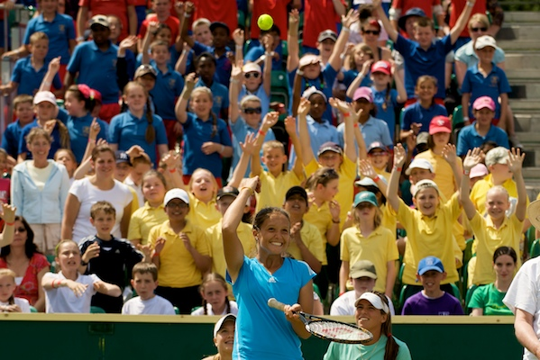 LIVERPOOL, ENGLAND - Tuesday, June 16, 2009: Laura Robson (GBR) throws a ball into the crowd to pick a school child to play a point on centre court during a special Kids Day before that start of the Tradition ICAP Liverpool International Tennis Tournament 2009 at Calderstones Park. (Pic by David Rawcliffe/Propaganda)