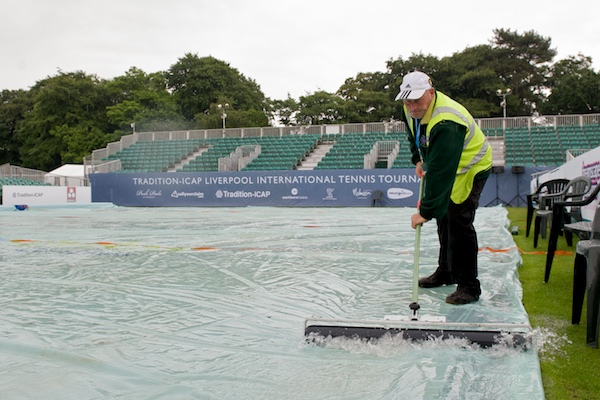 LIVERPOOL, ENGLAND - Wednesday, June 17, 2009: Groundsman Will Tomlinson clears water from the rain covers covering centre court as rain delays the start on Day One of the Tradition ICAP Liverpool International Tennis Tournament 2009 at Calderstones Park. (Pic by David Rawcliffe/Propaganda)