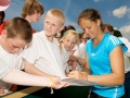 LIVERPOOL, ENGLAND - Tuesday, June 16, 2009: Laura Robson (GBR) signs autographs for fans after playing an exhibition match in front of 3,000 school children during a kids day at the Tradition ICAP Liverpool International Tennis Tournament 2009 at Calderstones Park. (Pic by David Rawcliffe/Propaganda)